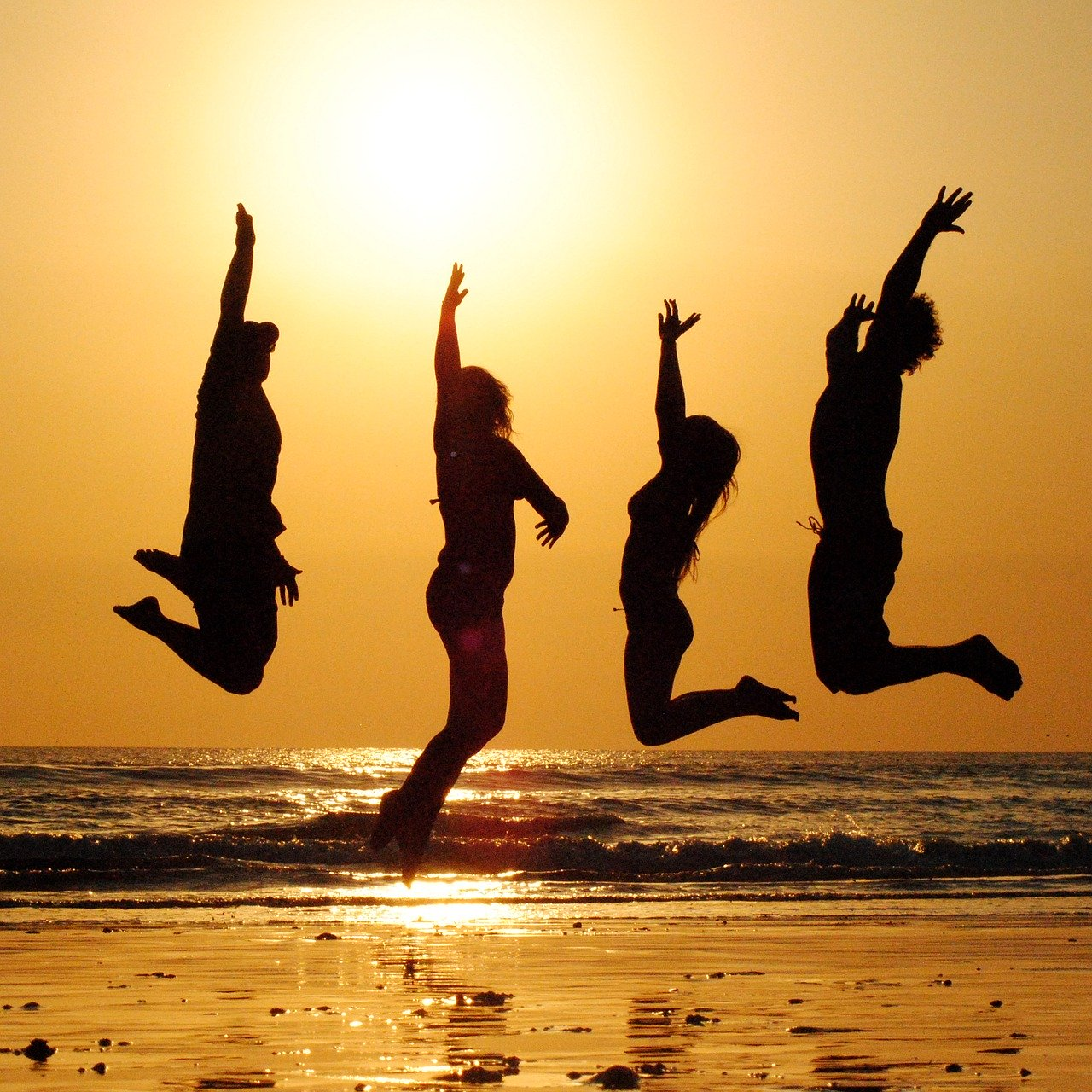 people jumping sunset