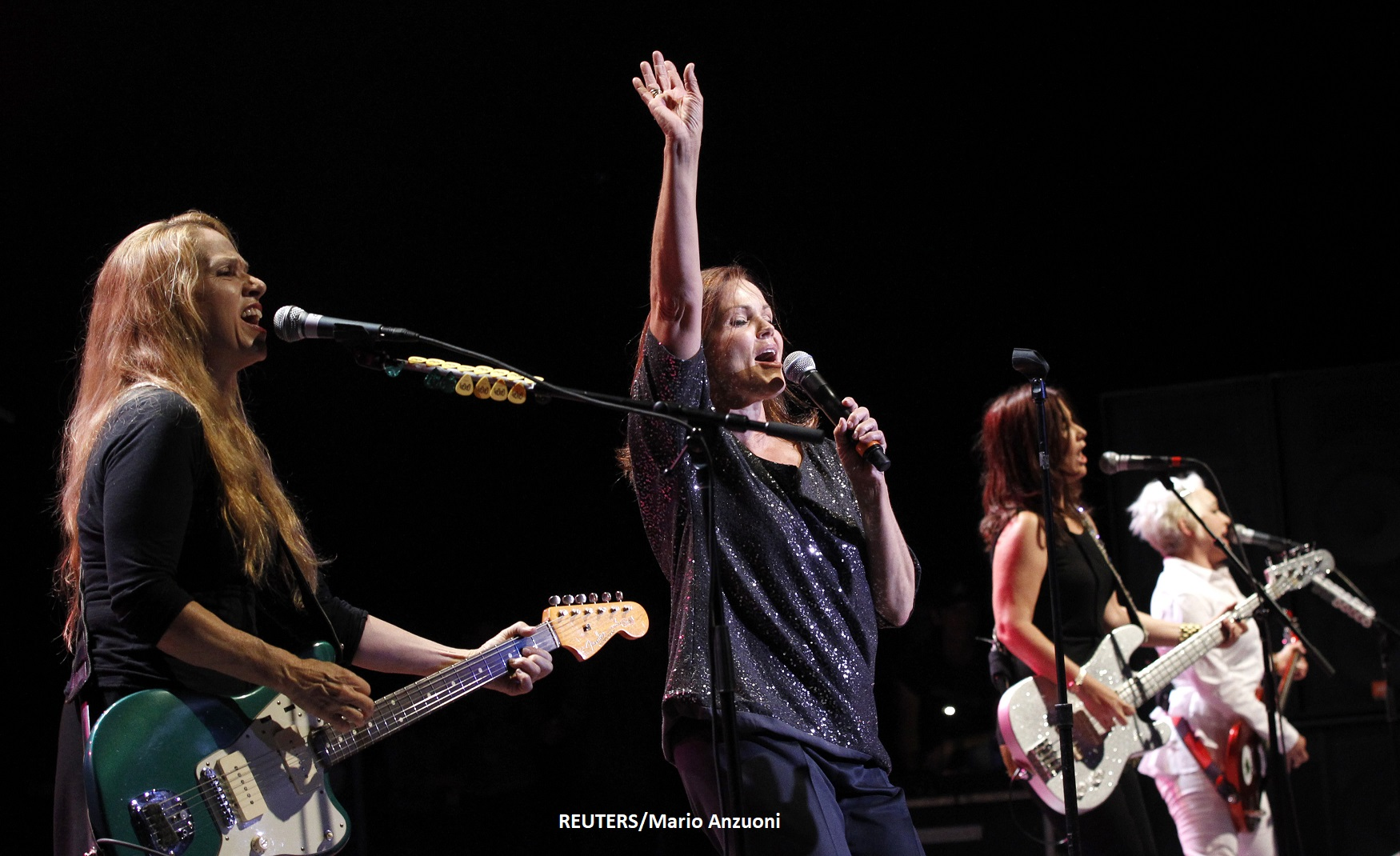 Caffey, Carlisle, Valentine and Wiedlin of American rock band The Go-Go's perform at the Greek theatre in Los Angeles